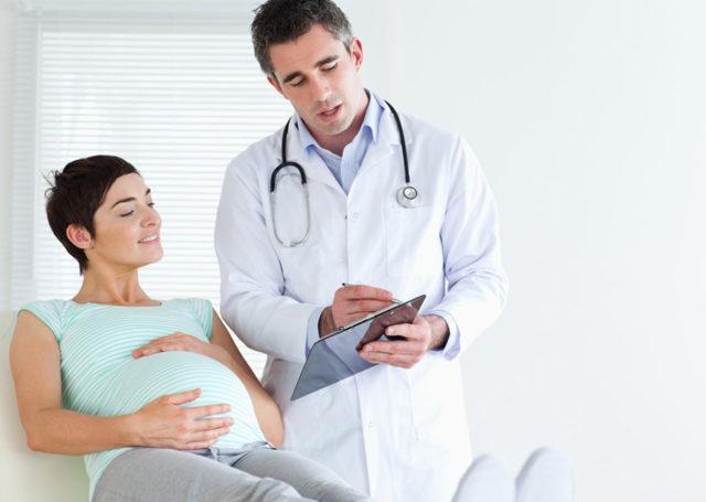 Болит поясница при беременности: почему ее тянет и что делать